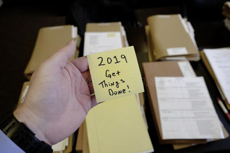 2019 Get Things Done Sticky Note Hand Files on Desk. Message Motivation stock image