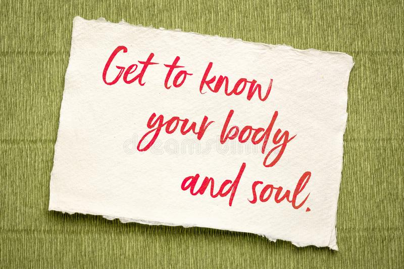 Get to know your body and soul. Inspirational handwriting on textured paper royalty free stock photography