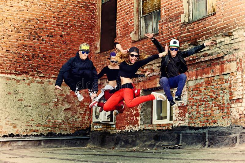 Get-together. Modern dancers dancing on the street. Urban lifestyle. Hip-hop generation royalty free stock images