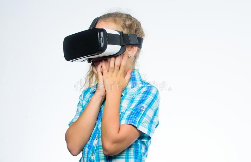 Get virtual experience. Virtual reality concept. Girl cute child with head mounted display on white background. Small. Kid use modern technology virtual reality stock image