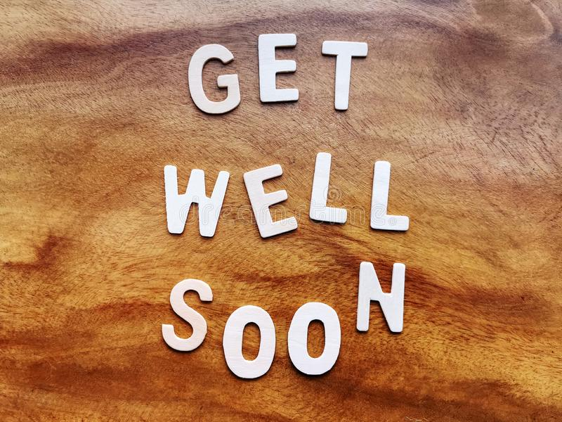 Get Well Soon Message on Wooden Table royalty free stock photos