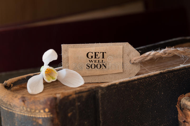 Get well soon. Snowdrop and card with lettering get well soon stock image
