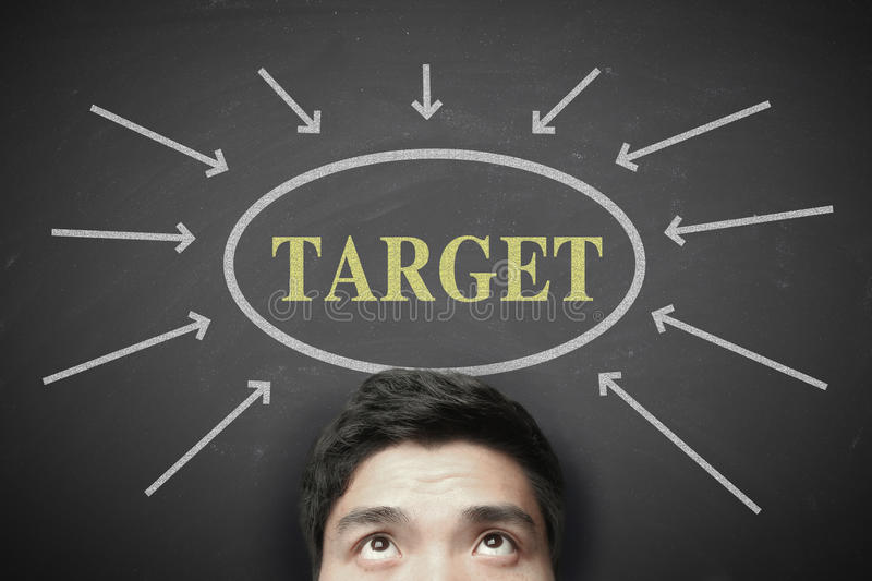 Get your target. Man with Get your target concept on the blackboard background royalty free stock photos
