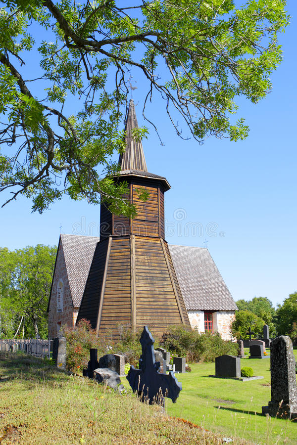 Geta Church Belfry in Aland Islands. Wooden historical belfry against country church in Geta, Aland Islands, Finland stock photo