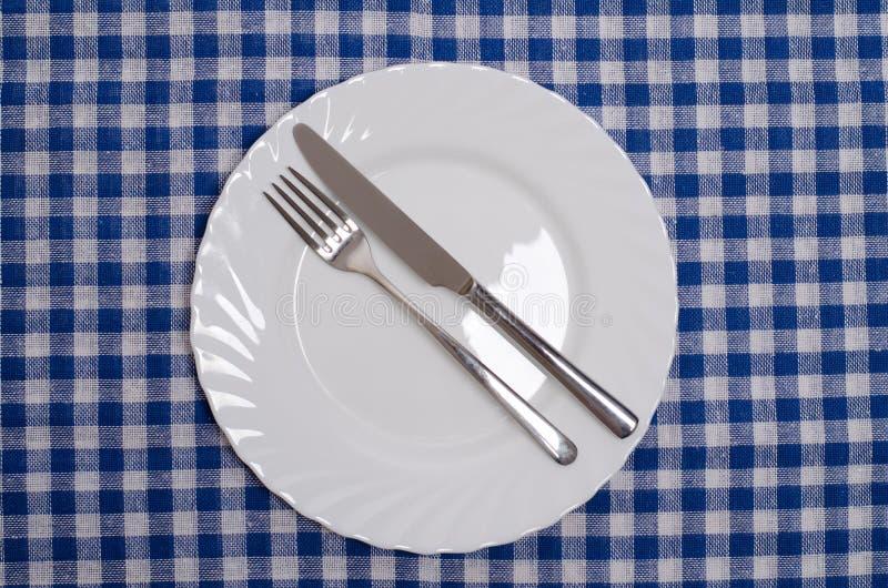 Getan - Tischmanieren stockbild