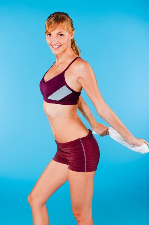 Getonte Frau in der Sportkleidung lizenzfreie stockfotografie