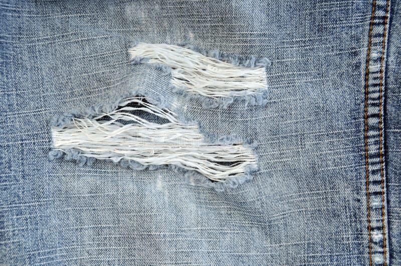 Getragene heraus Blue Jeans nah oben lizenzfreies stockfoto