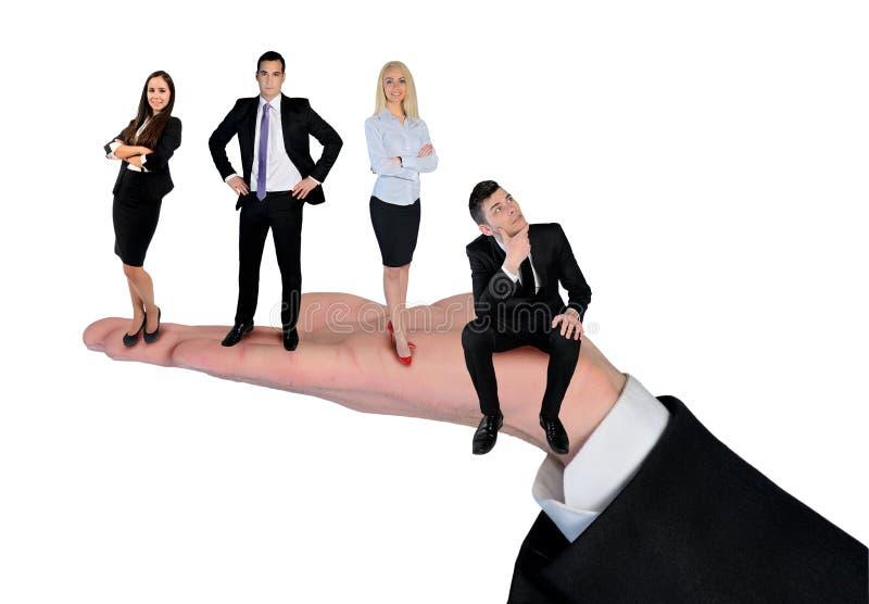 Getrennte Gruppe des jungen glücklichen lächelnden Geschäftsteams lizenzfreie stockfotografie