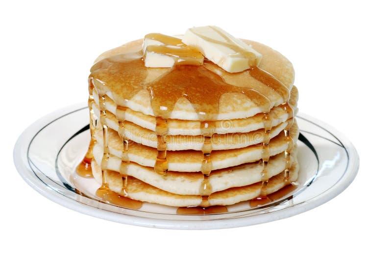 Getrennte Pfannkuchen mit Butter und Sirup stockfotografie
