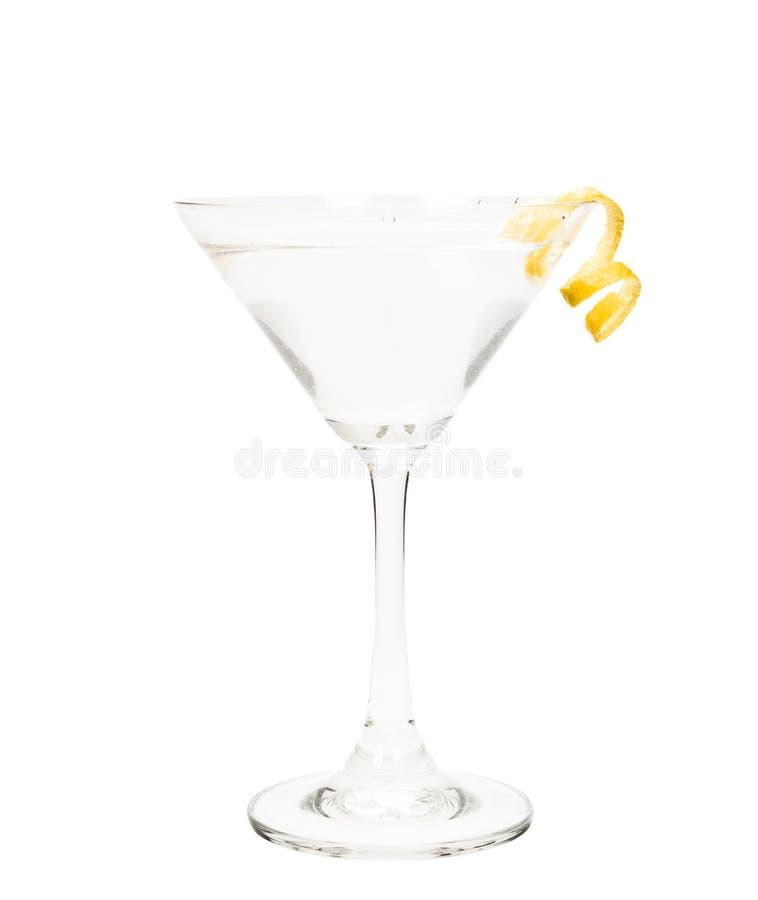 Getrennter Martini mit einer Zitronetorsion lizenzfreie stockfotos