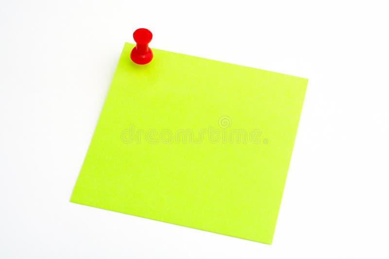 Getrenntes Grünbuch mit rotem pushnail stockbild