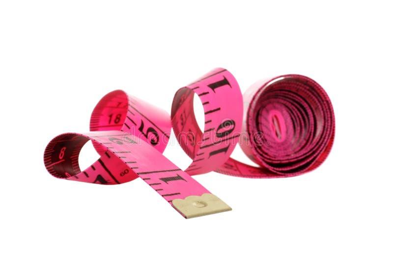 Getrenntes rosafarbenes Bandmaß stockbild