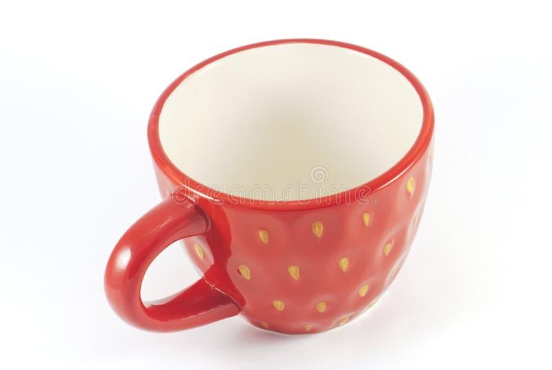 Getrenntes rotes Teecup stockfotografie