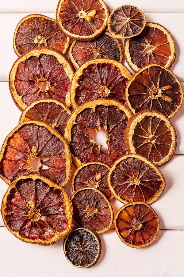 Getrocknet gebacken entwässerte kandiertes selbst gemachtes orange Zitrusfrucht-Chipmuster stockbild