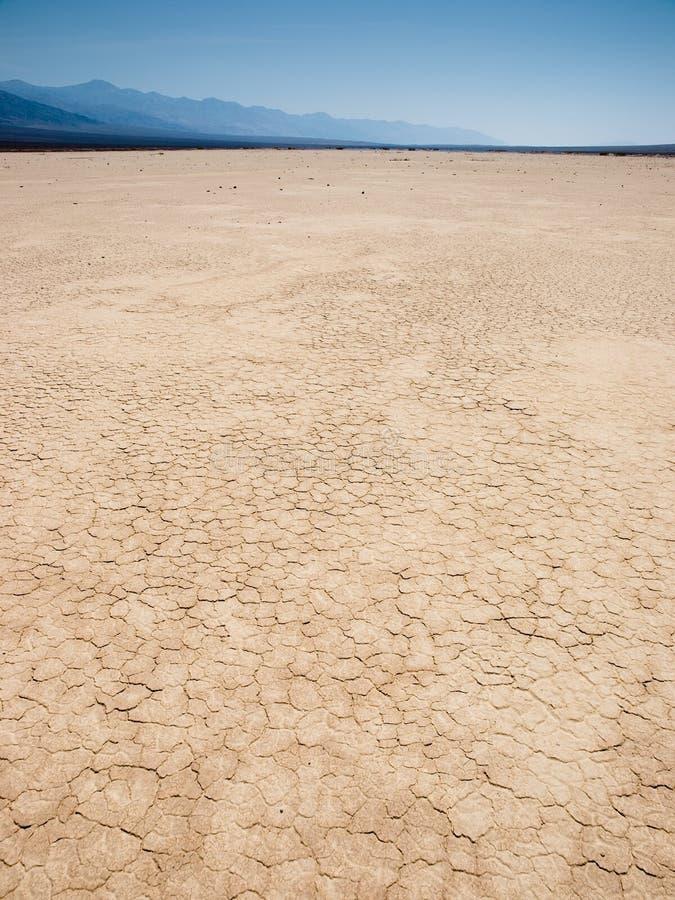 Getrocknete Erde in der Wüste lizenzfreie stockbilder
