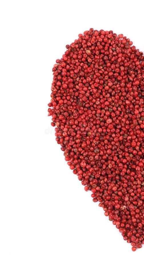 Getrockneter roter Pfeffer in Form der Herzhälfte lizenzfreie stockfotografie