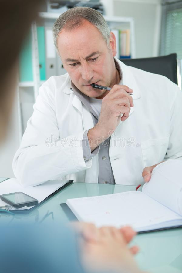 Getting appointment with doctor for consultation royalty free stock images