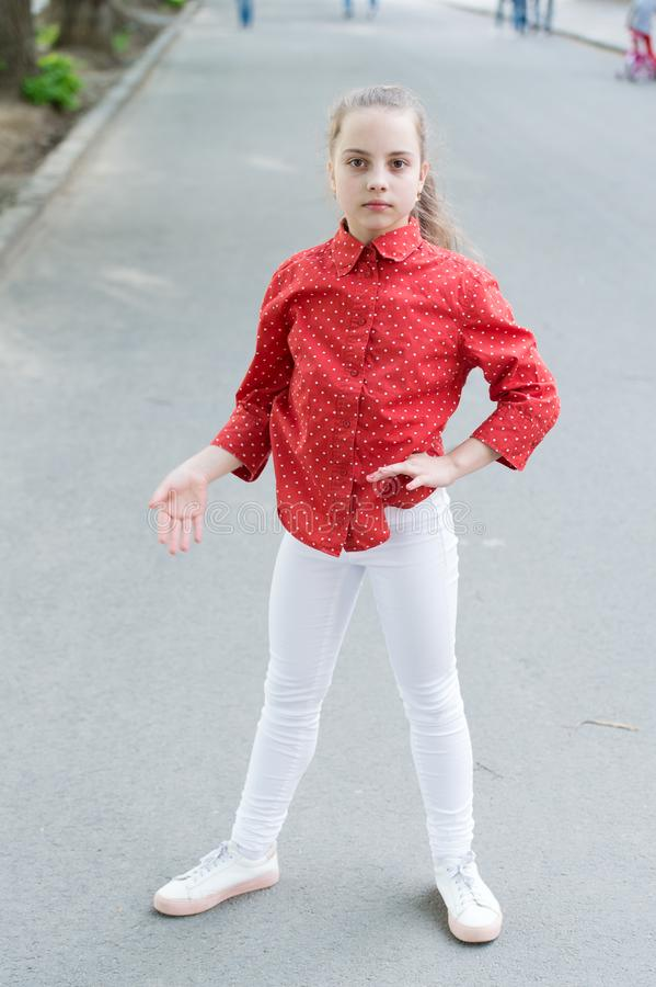 Getting a bit casual. Casual look of cute little child. Small girl wearing casual and spotted red shirt. Adorable kid stock images