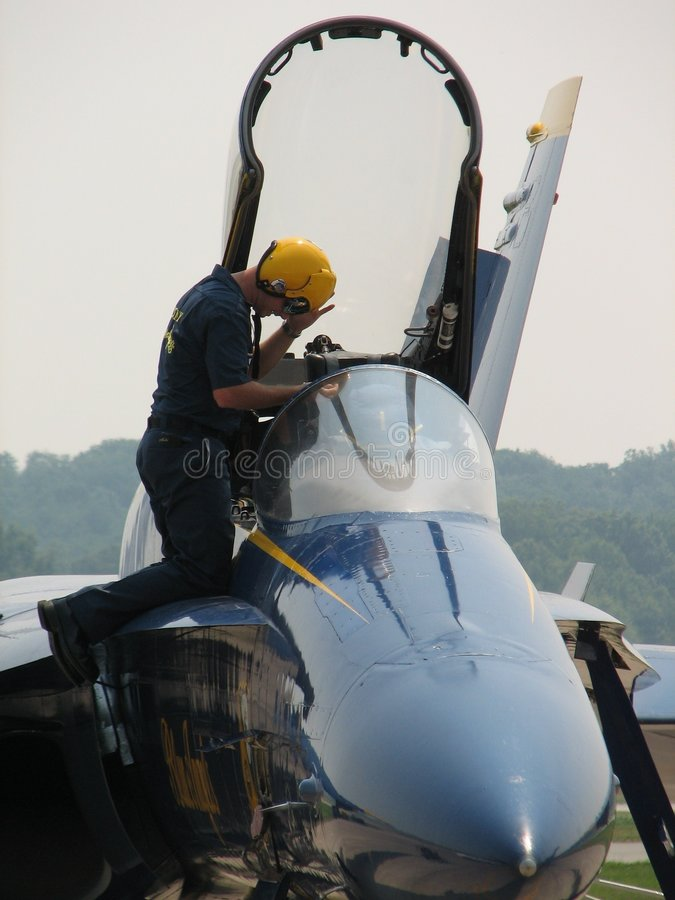 Getting in the Cockpit. Blue Angel's pilot getting into the cockpit at a local air show royalty free stock images