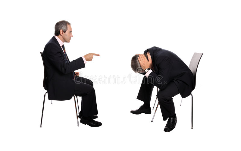 Getting Fired. Businessman firing an employee, isolated on white background stock image