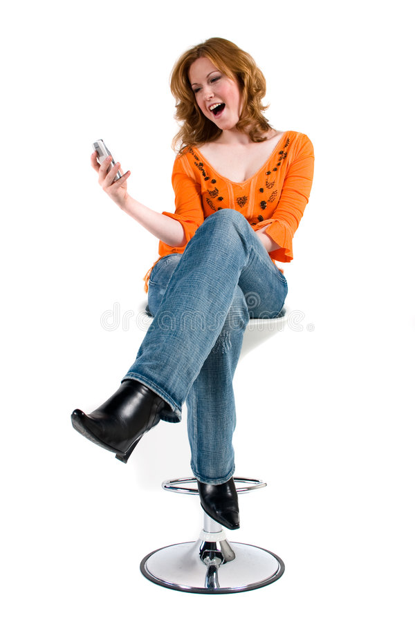 Getting A Funny Text Message Royalty Free Stock Image