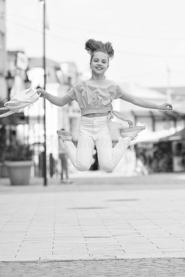 Getting higher and more active. Active little girl in motion on urban background. Happy small child jumping active for. Pleasure. Active and energetic kid stock images