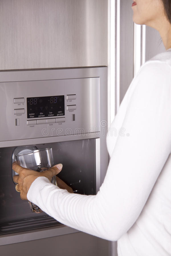 Download Getting Ice From The Refrigerator Stock Photo - Image: 10489022