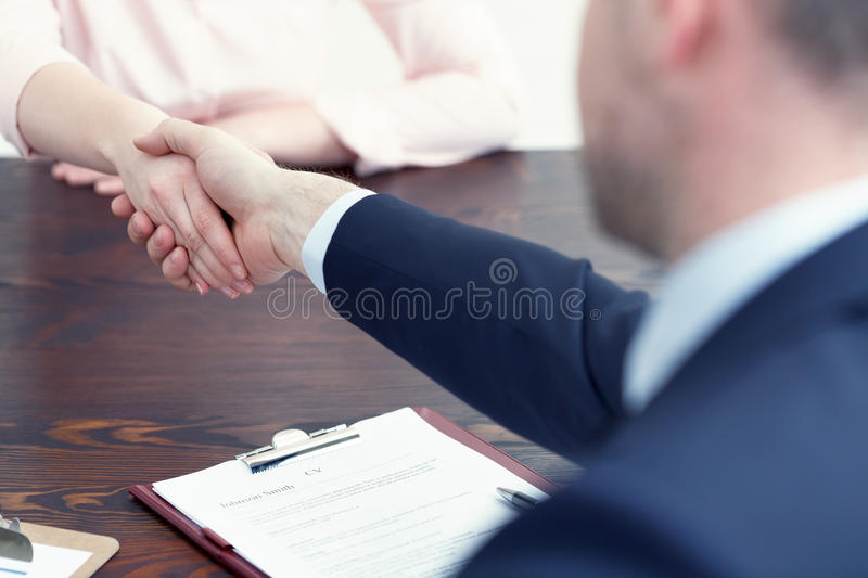 Getting a job. Woman getting a job after successful interview royalty free stock photos