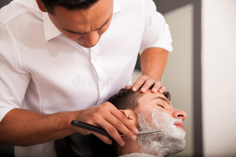 Getting my beard shaved stock image