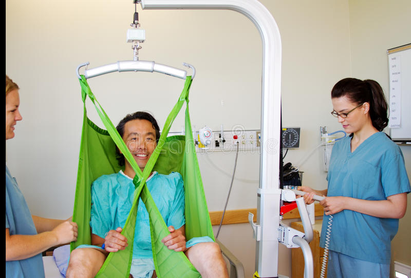 Download Getting Patient Out Of Bed With Lift Stock Image - Image: 36674539