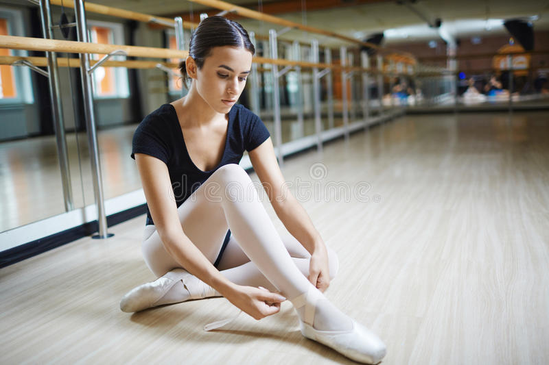 Getting ready for ballet class stock photography