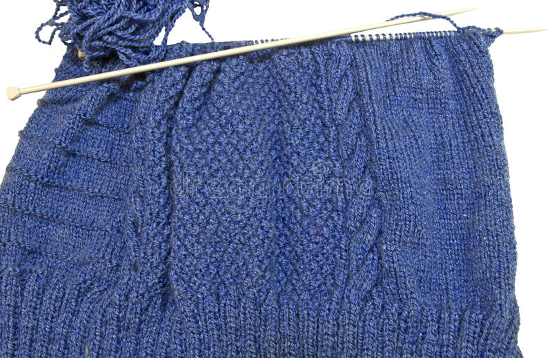 Getting ready for cold winter days. Knitting a sweater for cooler fall and winter days royalty free stock images