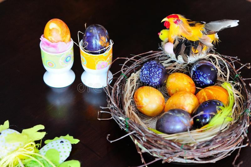Getting ready for Easter. Easter eggs composition on a table stock images