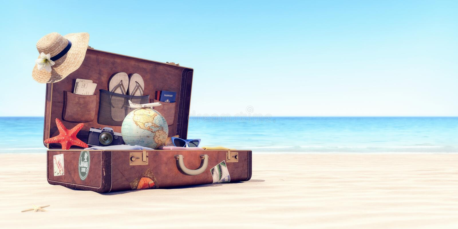 Getting ready for summer holidays - Leather suitcase with travel accessories stock photo
