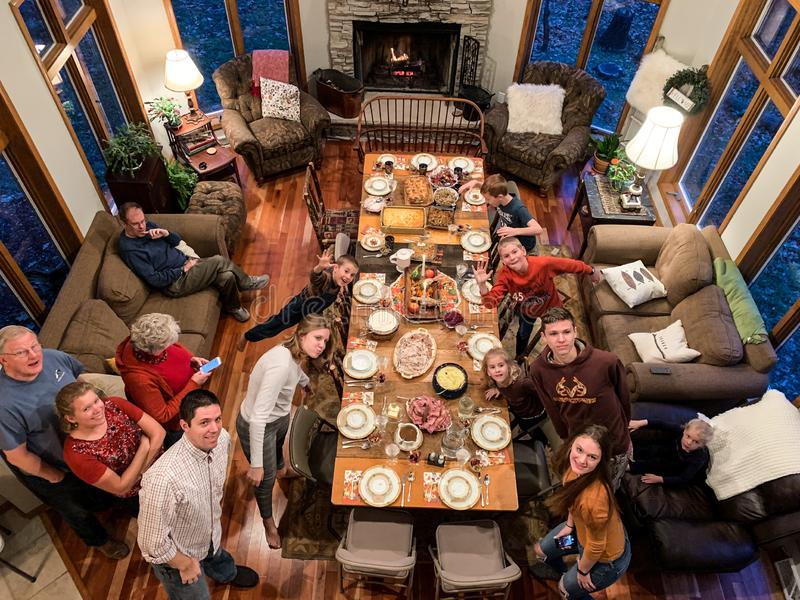Getting Ready For A Thanksgiving Feast. Family getting ready for a large Thanksgiving feast. The meal and food all ready and the table set with the good china in royalty free stock photography