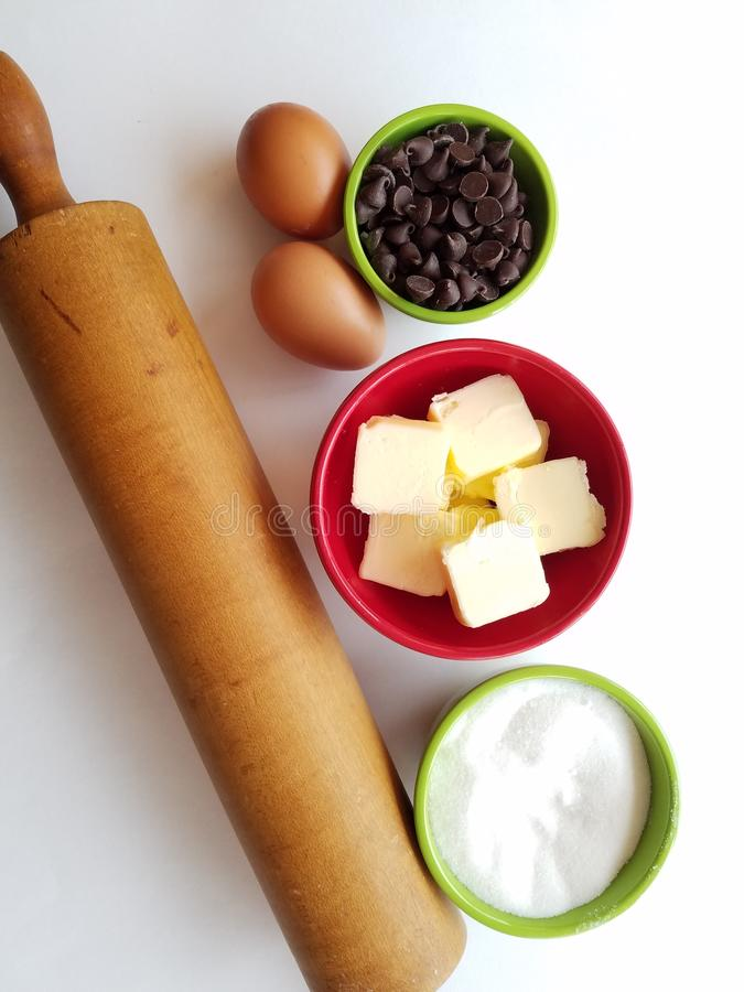 Getting ready to bake - aboveview of baking ingredients with Nana`s heirloom rolling pin royalty free stock image