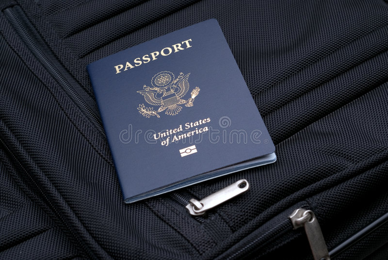 Getting ready for the trip. Passport on a suitcase to show packing for a trip stock image