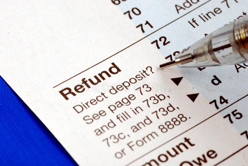Getting refund from the income tax return. Isolated on blue stock photo