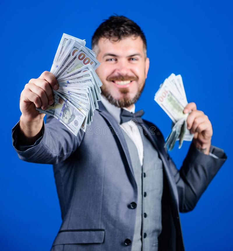 Getting rich quick. Currency broker with bundle of money. Bearded man holding cash money. Making money with his own royalty free stock photo