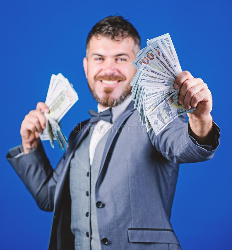 Getting rich quick. Currency broker with bundle of money. Bearded man holding cash money. Making money with his own royalty free stock photos