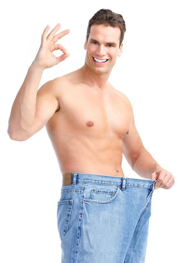 Getting slim. Man with big jeans stock image