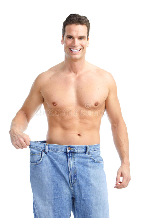 Getting slim. Man with big jeans royalty free stock photography