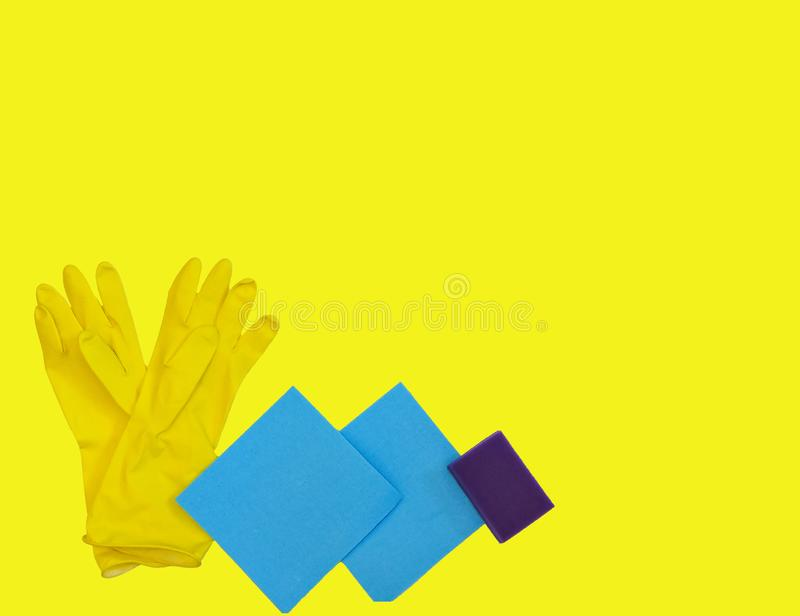 Getting started cleaning. Yellow rubber gloves for cleaning on Yellow background .General or regular cleanup. royalty free stock image