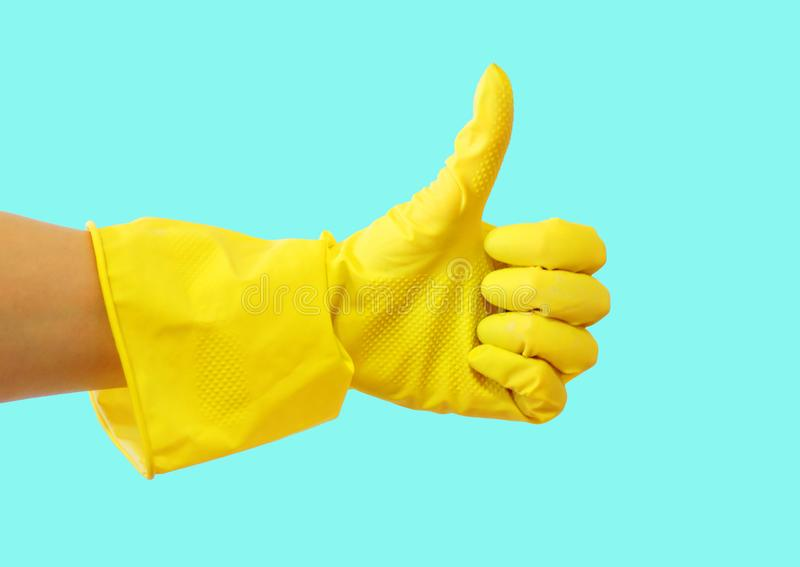 Getting started cleaning. Yellow rubber gloves for cleaning on blue background .General or regular cleanup. stock photo