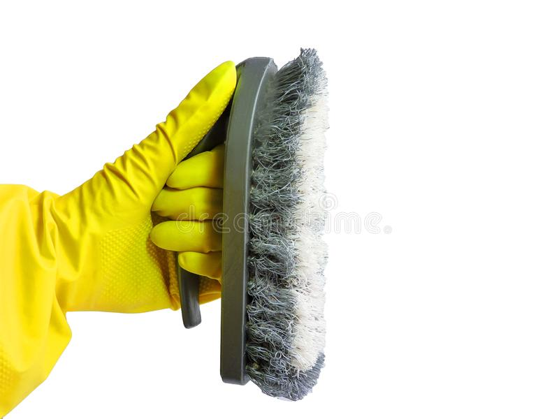 Getting started cleaning. Yellow rubber gloves for cleaning on white background .General or regular cleanup. stock photos