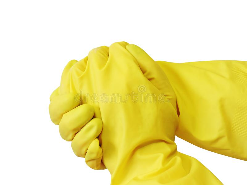 Getting started cleaning. Yellow rubber gloves for cleaning on white background royalty free stock photos