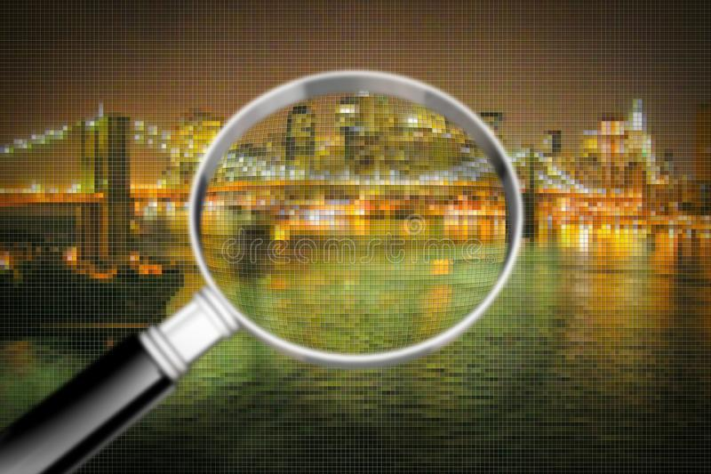Getting to know Manhattan - Concept image seen through a magnifying glass with pixelation effect - Manhattan waterfront with. Brooklyn Bridge at night - New royalty free stock photos