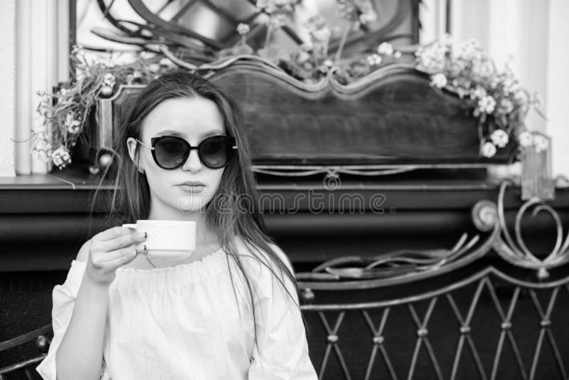 Getting warm with fresh coffee. summer fashion. Meeting in cafe. morning coffee. Waiting for date. girl relax in cafe royalty free stock image