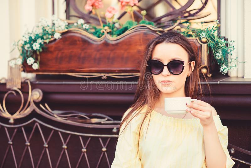 Getting warm with fresh coffee. summer fashion. Meeting in cafe. morning coffee. Waiting for date. girl relax in cafe stock photo