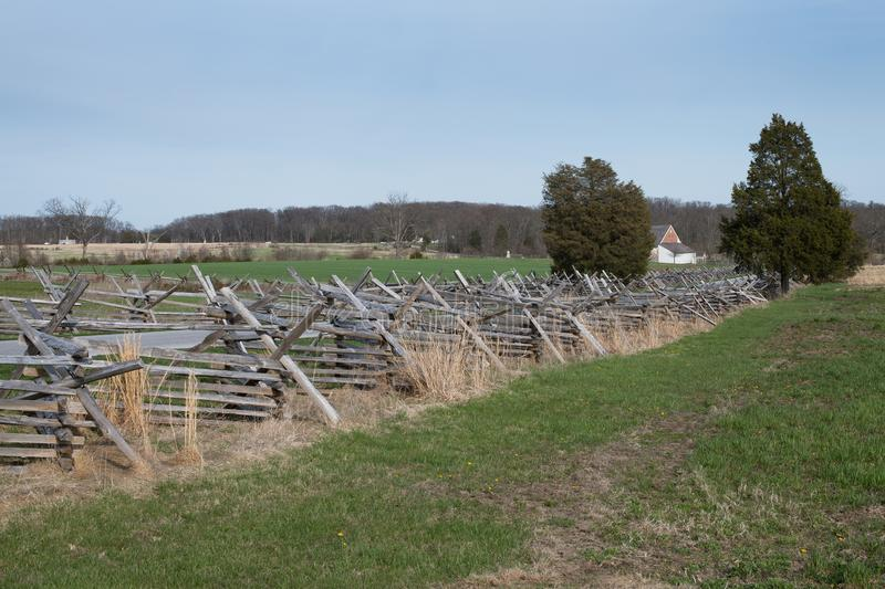 Gettysburg Battlefield with Split-Rail Fence. Gettysburg Battlefield. Split-rail fence along a field of grass and United States Avenue royalty free stock photos